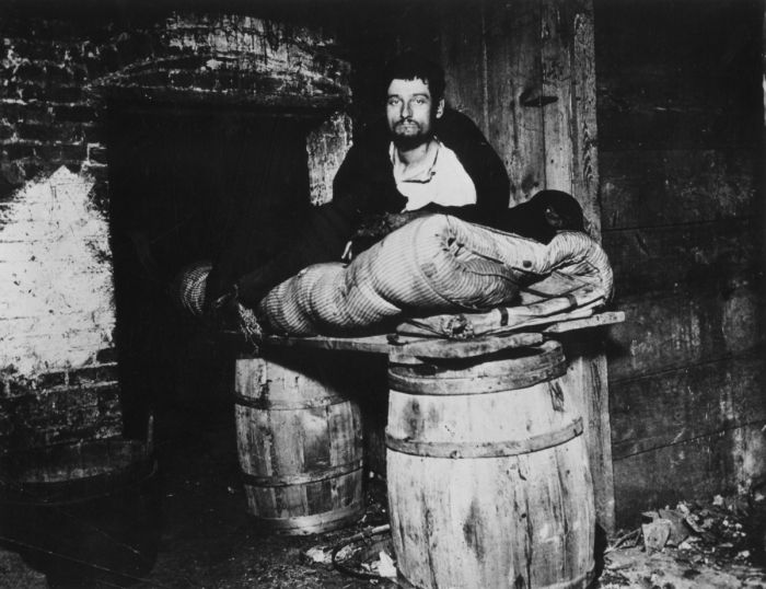 circa 1887: The cellar of 11 Ludlow Street in New York, where beggars sleep in squalid conditions. The photograph was taken by Jacob A Riis, a New York reporter with the 'Tribune', who later went on to become a social reformer and author. (Photo by Jacob A. Riis/Hulton Archive/Getty Images)