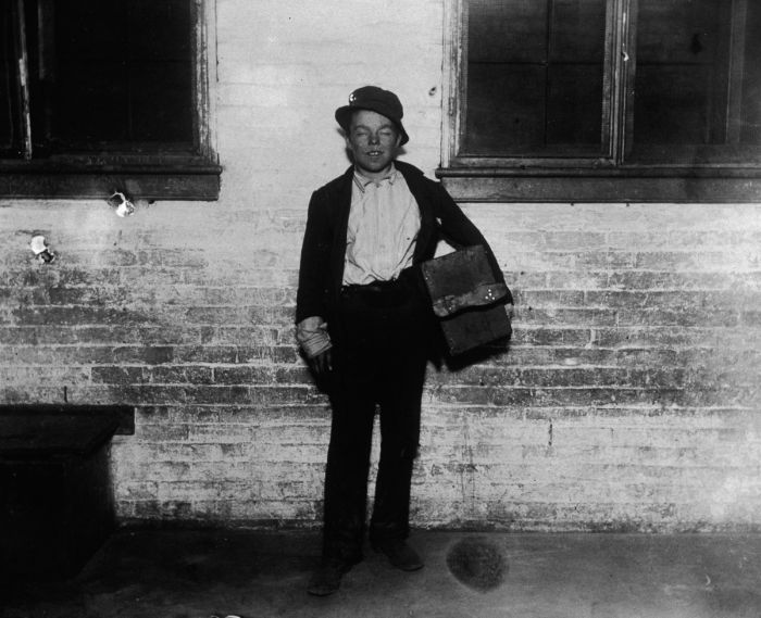 circa 1890: Portrait of a disheveled shoeshine boy named Tommy, holding a shoeshine kit on a sidewalk, New York City. (Photo by Jacob A. Riis/Museum of the City of New York/Getty Images)